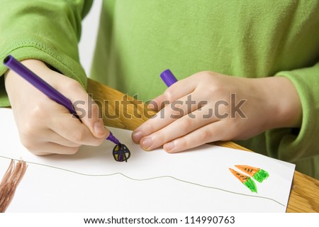 Children drawing with markers on the grey background - stock photo
