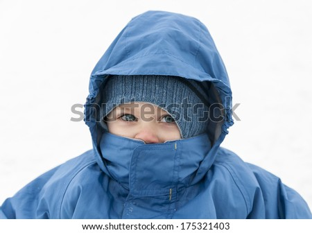 Children dressed in winter clothes on white background - stock photo