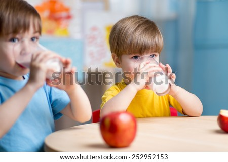 children eating healthy food at home or kindergarten - stock photo