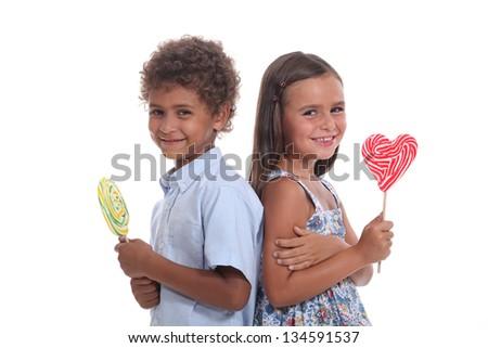 children eating lollipops - stock photo