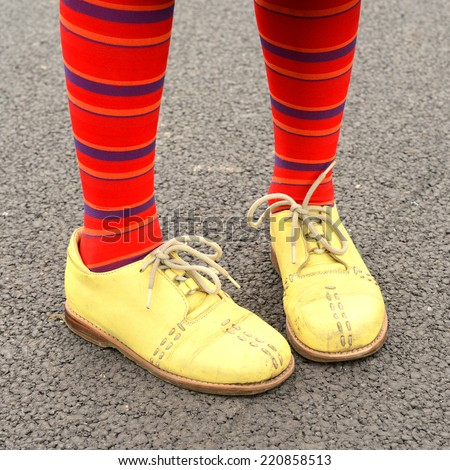 Children feet in bright stockings and boots - stock photo