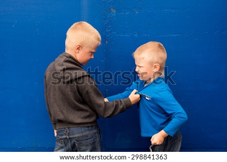 children fight between two angry aggressive brothers (kids, boys) - stock photo