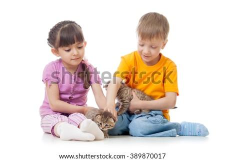 Children girl and boy stroking kittens - stock photo