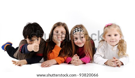 Children group family laying on ground floor isolated - stock photo