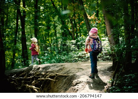 children having a walk in the woods - stock photo