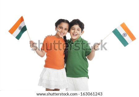 Children holding Indian flags - stock photo