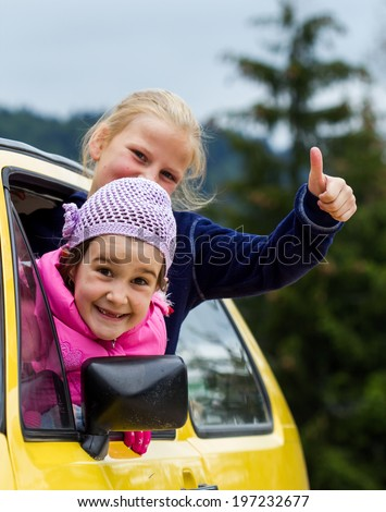 Children in a car - stock photo