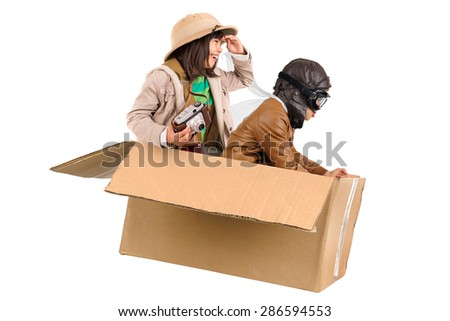 Children in a cardboard box playing Safari - stock photo