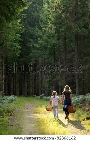 Children in forest - stock photo