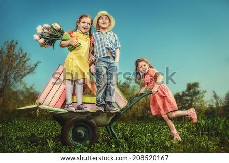 Children in the garden  - stock photo