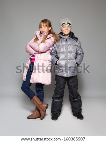 Children in winter clothes. Kids in down jackets. Fashion child - stock photo