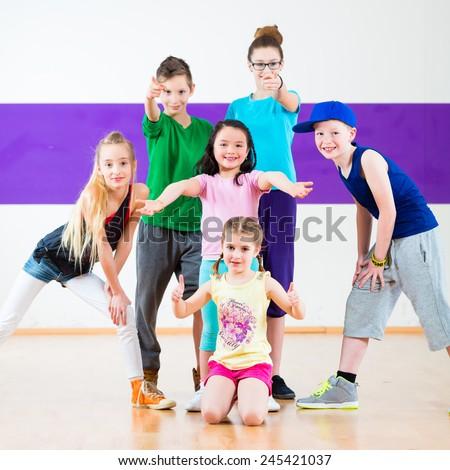 Children in zumba class dancing modern group choreography  - stock photo