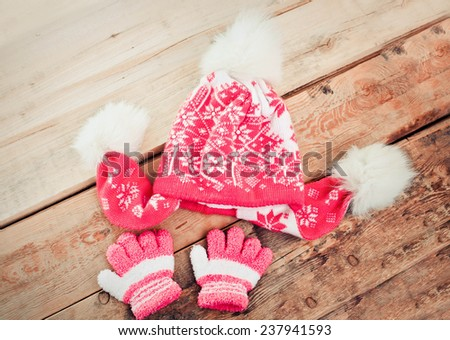 Children is cap, scarf and gloves - stock photo