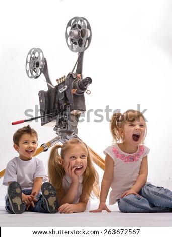 Children laugh, watch movies  - stock photo