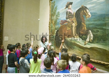 Children learn about paintings in Museum de Prado, Prado Museum, Madrid, Spain - stock photo