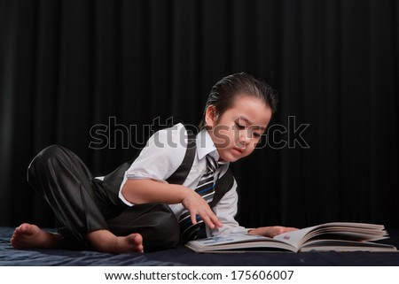 Children learn the book yourself; Thailand - stock photo