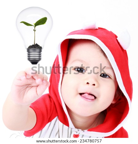 Children looking at the bulb with a tree inside. The concept of natural - stock photo