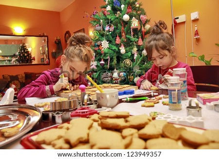 Children make cakes on the Christmas eve - stock photo