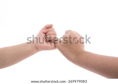 Children making a pinkie promise. Hands isolated on white background. - stock photo