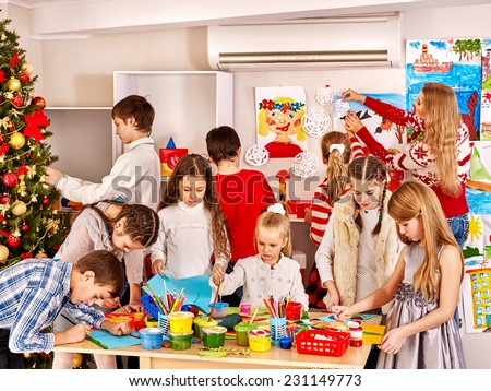 Children making greeting card. Indoor. - stock photo