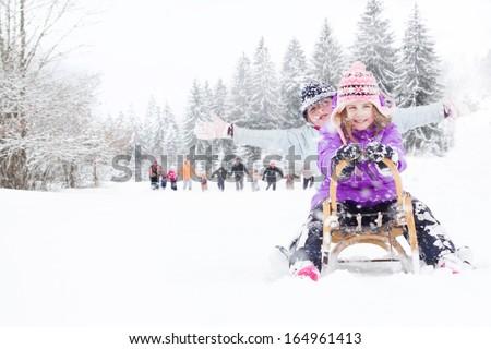 Children on the snow - stock photo