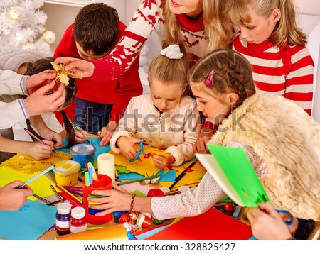 Children painting and cut sissors paper at art school. Education. - stock photo