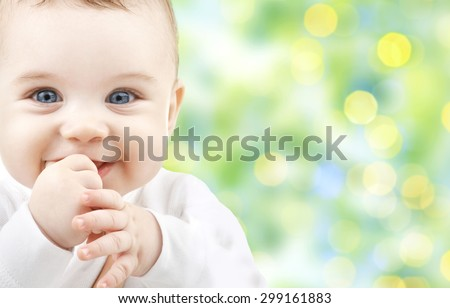 children, people, infancy and age concept - beautiful happy baby over green lights background - stock photo