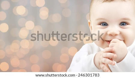 children, people, infancy and age concept - beautiful happy baby over holidays lights background - stock photo