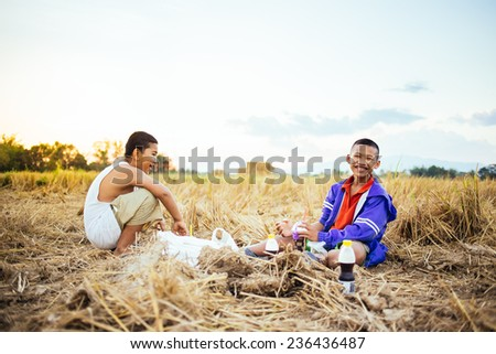 children picnic in the rice fields - stock photo