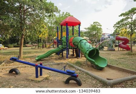 children play ground in park of thailand - stock photo