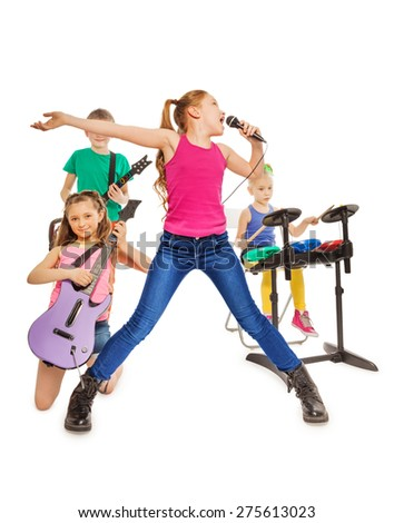 Children play musical instruments and girl sings - stock photo