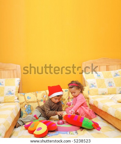 children play with christmas gifts - stock photo