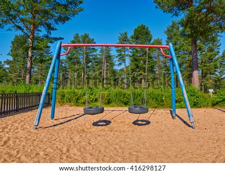 Children Playground in the Pine Forsest Camping - stock photo
