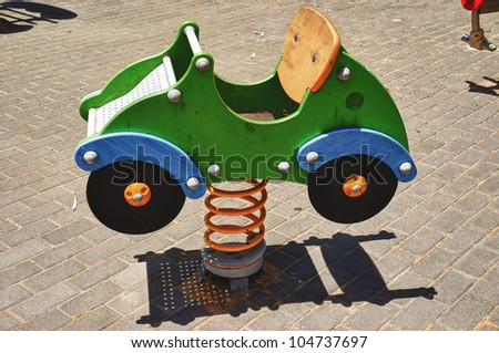 Children playground, toy car in park Moret, Andalusia - stock photo