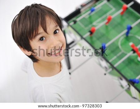 Children playing board soccer - stock photo