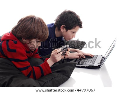 children playing computer and video games - stock photo
