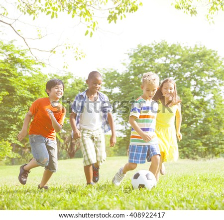 Children Playing Football Park Concept - stock photo