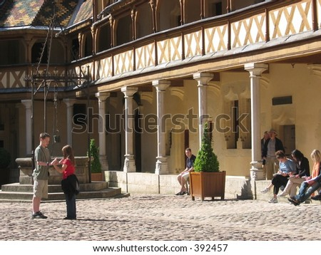 Children playing in front of Hotel Dieu, Beaune, France. - stock photo