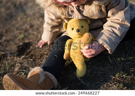Children playing in the teddy bear - stock photo