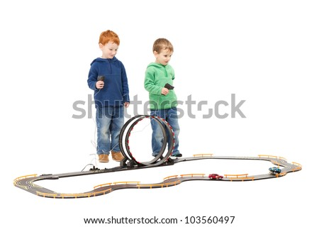 Children playing kids racing toy electric slot car game. On white. - stock photo