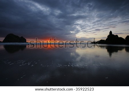 Children playing on beach during sunset, face blurred - stock photo