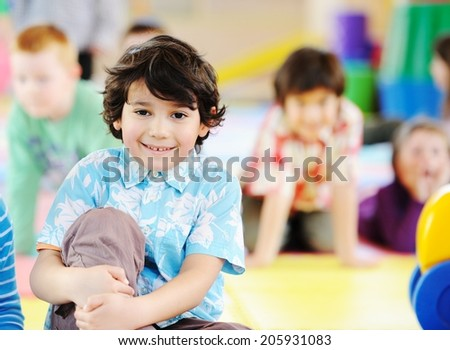Children playing on colorful kindergarten playground - stock photo