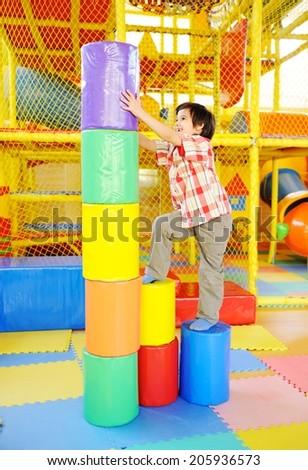 Children playing on colorful kindergarten playground - stock photo