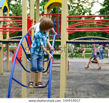 children playing on  playground in summer outdoor park - stock photo