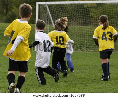 Children Playing Soccer - stock photo
