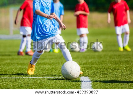 Children Playing Soccer Game on the Professional Football Pitch. Football Soccer Tournament for Youth Teams. - stock photo
