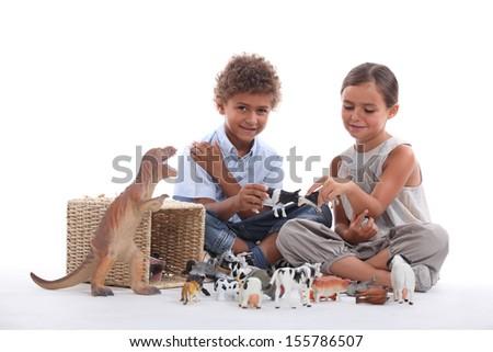 Children playing, studio shot - stock photo