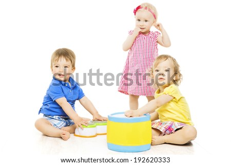 Children playing toys. Small Kids and Baby development, isolated over white background - stock photo