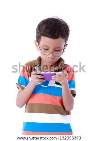 children playing with a cell highly concentrated - stock photo