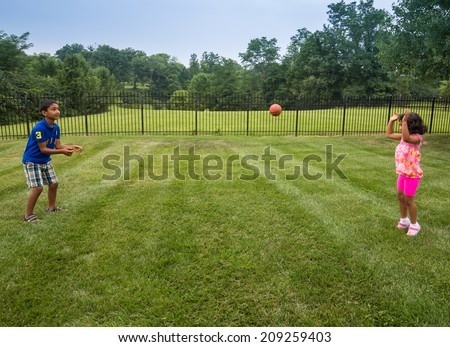 Children Playing with Ball in a Park - stock photo